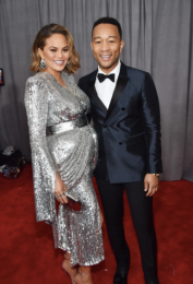 Chrissy Teigen in Yanina Couture and John Legend in Burberry, Chopard jewelry and Bruno Magli shoes