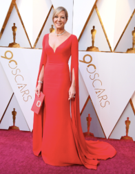 Allison Janney in Reem Acra and with a Roger Vivier bag