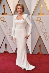 Jane Fonda in custom Balmain, Chopard jewelry, Perrin bag and Salvatore Ferragamo shoes