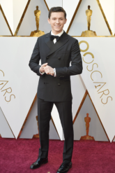 Tom Holland in custom Hermès and Piaget jewelry
