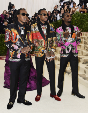 Takeoff, Quavo, and Offset of Migos, all in Versace
